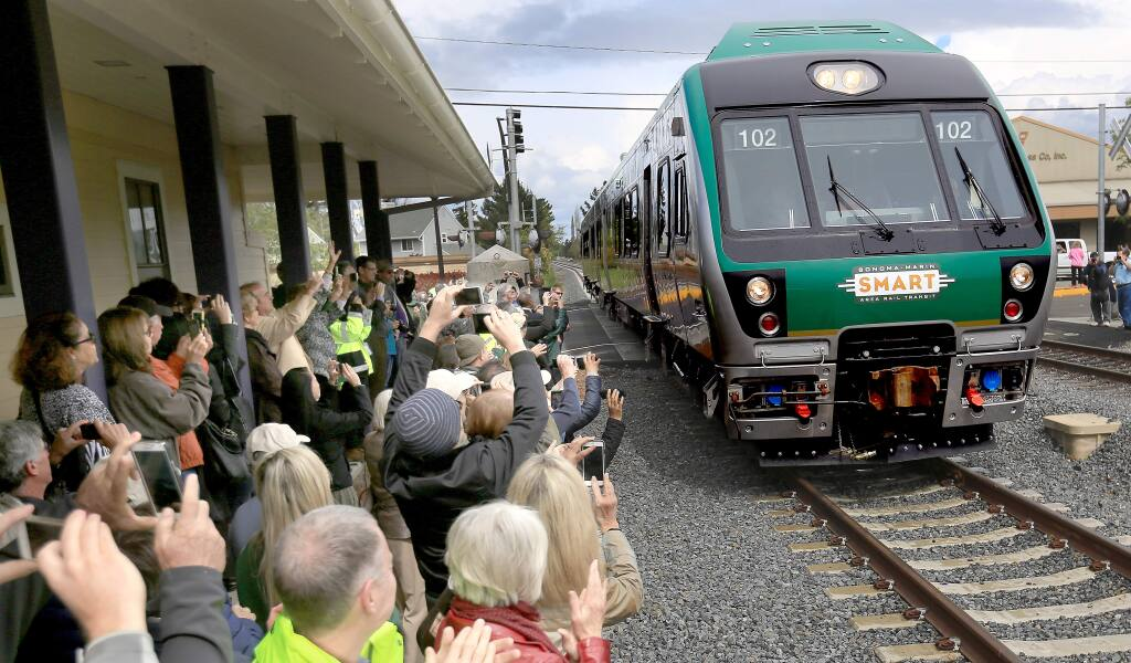 A SMART commuter train, Tuesday April 7, 2015 pulls in to the Cotati train depot, for an official unveiling of the train cars. (Kent Porter / Press Democrat) 2015