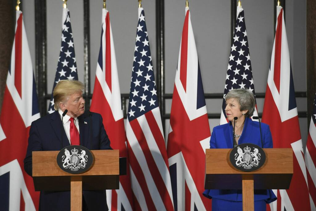 Britain's Prime Minister Theresa May and US President Donald Trump take part in a joint press conference at the Foreign & Commonwealth Office, in London, Tuesday June 4, 2019. Moving from pageantry to policy during his state visit to Britain, President Donald Trump on Tuesday urged embattled Prime Minister Theresa May to 'stick around' to complete a U.S.-U.K. trade deal, adding to this recent chapter of uncertainty in the allies' storied relationship. (Stefan Rousseau/Pool via AP)