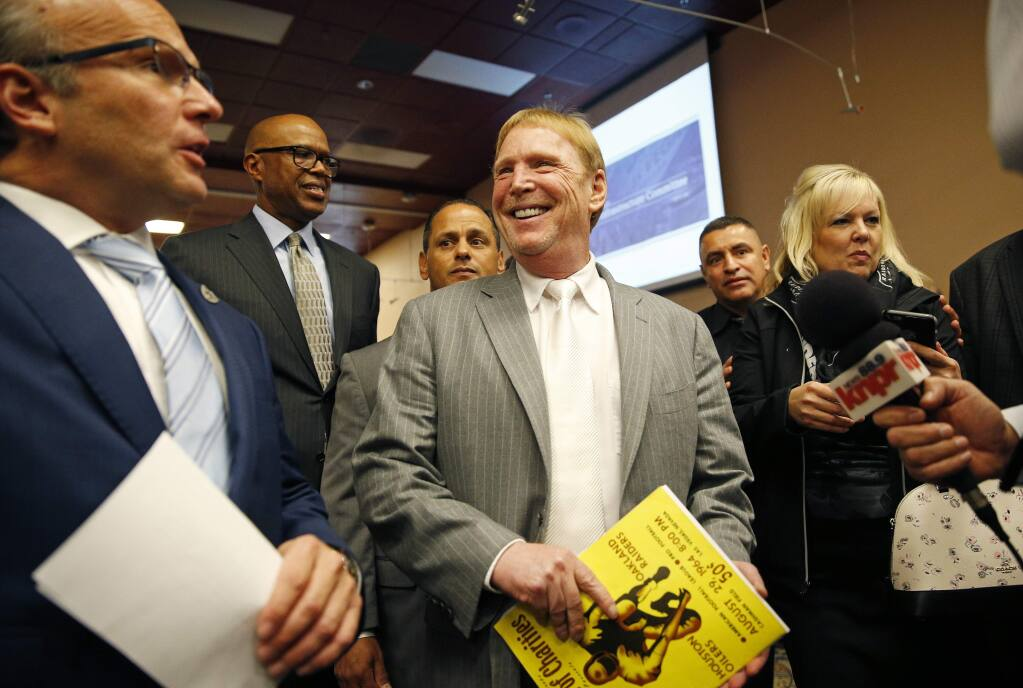 Oakland Raiders Owner Mark Davis smiles as he leaves a meeting of the Southern Nevada Tourism Infrastructure Committee, Thursday, April 28, 2016, in Las Vegas. Davis says he wants to move the team to Las Vegas and is willing to spend a half billion dollars as part of a deal for a new stadium in the city.(AP Photo/John Locher)