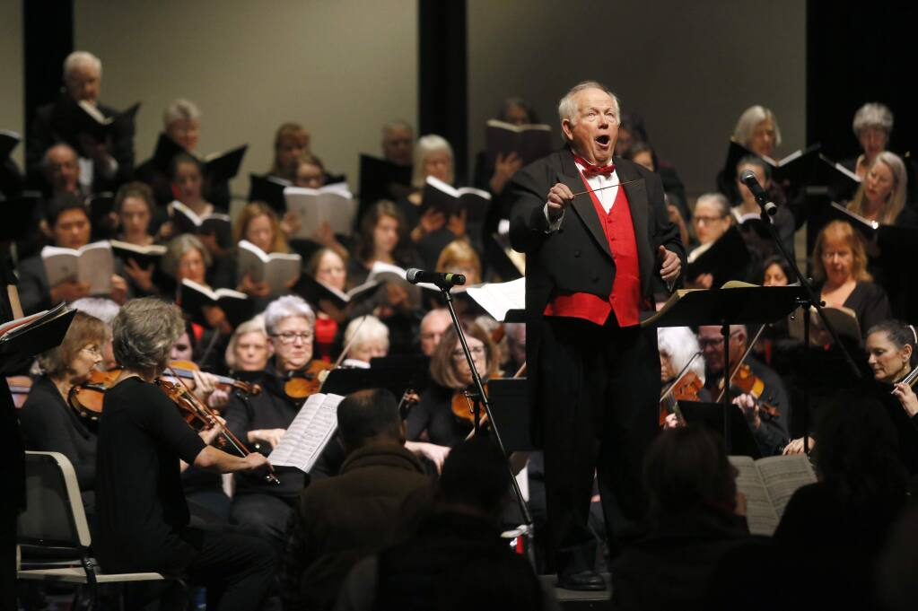Daniel Earl leads concert goers and members of the Santa Rosa Symphonic Chorus, Santa Rosa Chamber Orchestra and SRJC Concert Choir and Chamber Singers during the 36th Annual Redwood Empire Sing-Along Messiah at Sonoma Country Day School on Sunday, December 18, 2016 in Santa Rosa, California . (BETH SCHLANKER/The Press Democrat)