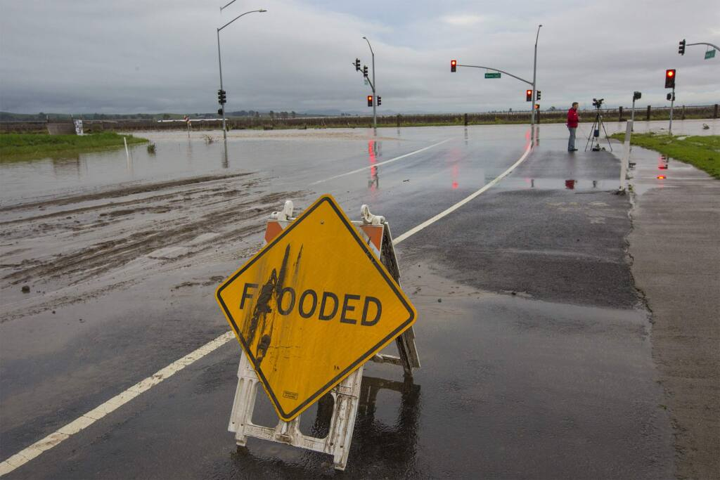 Friday's rainfall will break Santa Rosa's record for most rainfall in a recorded season. Scroll through the gallery to see photos from recent and previous storms. Here, the intersection of Highway 121 and Broadway in the Sonoma Valley flooded during a storm in January 2017. (Photo by Robbi Pengelly/Index-Tribune)