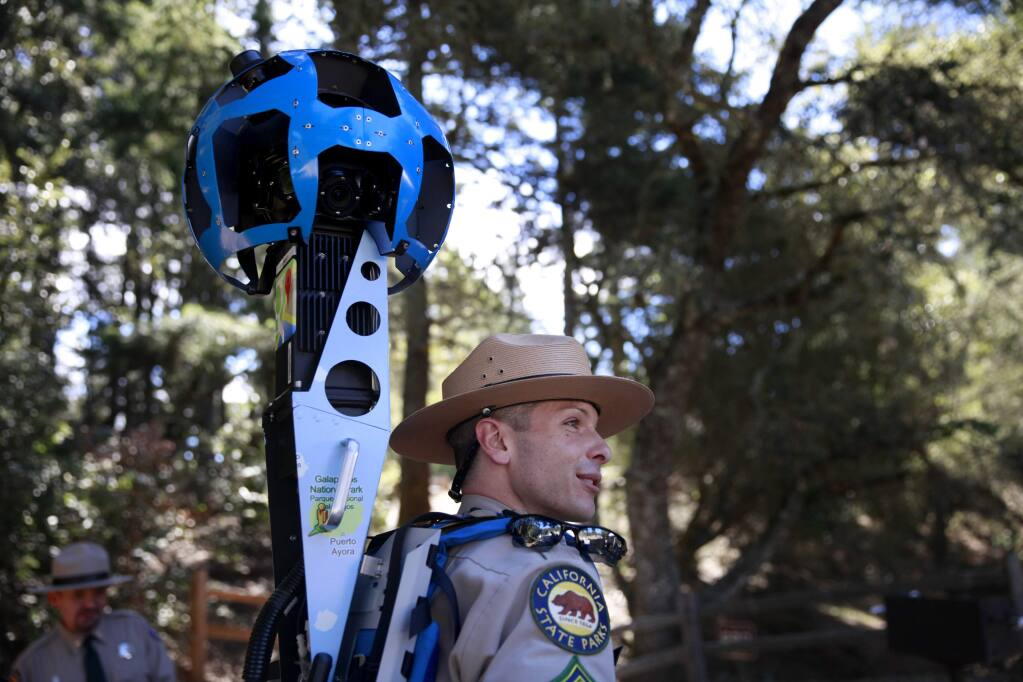 Roberto Walton, a supervising ranger for California State Parks, tries on the Google Trekker, a street view camera mounted in a backpack, at Mount Tamalpais State Park on Tuesday, October 7, 2014 near Mill Valley , California. (BETH SCHLANKER/ The Press Democrat)