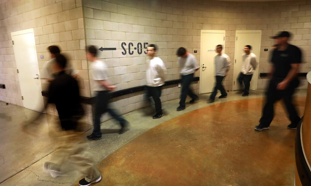 Sonoma County Juvenile Hall guards walk inmates from their unit to a meeting at the facility at the base of Hood Mountain in 2017. (JOHN BURGESS/ PD)