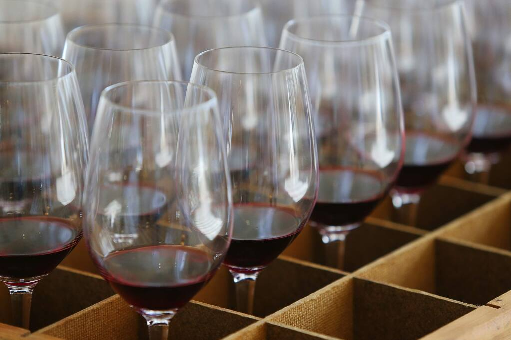 Glasses of merlot are ready to be brought in for judging for the Harvest Fair at the Sonoma County Fairgrounds in Santa Rosa on Tuesday, Sept. 18, 2018. (CHRISTOPHER CHUNG/ PD)