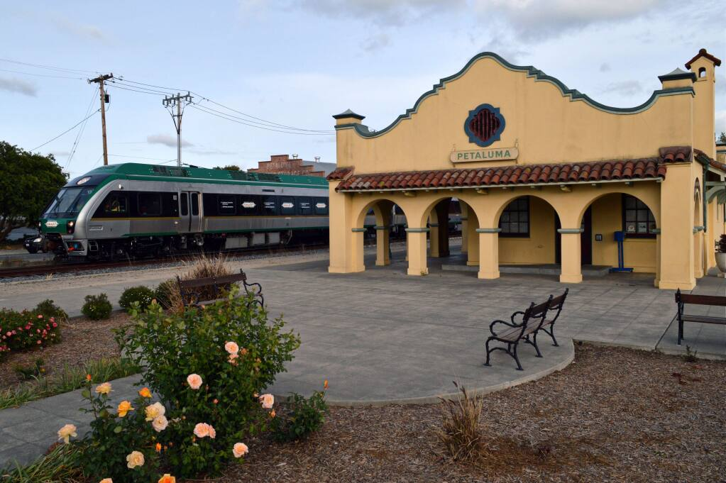 The first SMART train leaves the downtown Petaluma rail depot on Lakeville Street. BEN MARGHERONE/FOR THE ARGUS-COURIER