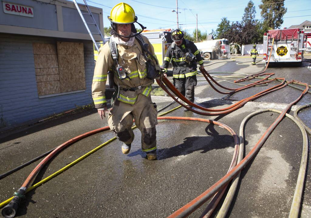 Petaluma, CA, USA._Thursday, July 18, 2019._Firefighters from throughout Petaluma and nearby participated in a training with the rare opportunity to practice on fires in an existing structure to simulate several scenarios. (CRISSY PASCUAL/ARGUS-COURIER STAFF)