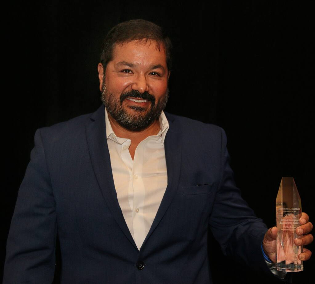 Mike Lopez of Vantreo Insurance Brokerage accepts one of North Bay Business Journal's Latino Business Leadership Awards, held at Hyatt Regency Sonoma Wine Country on Oct. 27, 2017. (JEFF QUACKENBUSH / NORTH BAY BUSINESS JOURNAL)