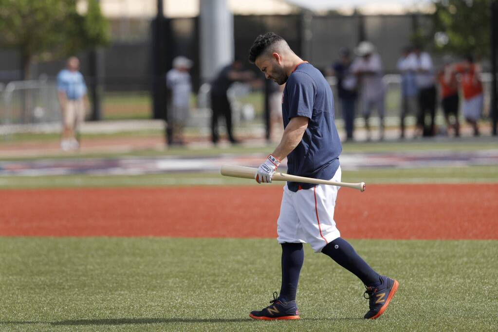 The Houston Astros' Jose Altuve carries a bat as he heads out to hit during spring training Thursday, Feb. 13, 2020, in West Palm Beach, Fla. (AP Photo/Jeff Roberson)