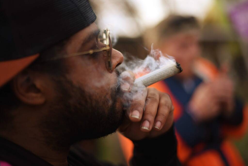 Tony Cocho, of Mendocino enjoying a joint during Emerald Cup held at Sonoma County Fairgrounds in Santa Rosa, Calif. on Saturday, Dec. 14, 2019.(Photo: Erik Castro/for The Press Democrat)