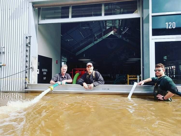 The crew at Seismic helping a neighbor, Crooked Goat, dry out their brewery after recent flooding in Sebastopol. (Courtesy of Seismic Brewing)