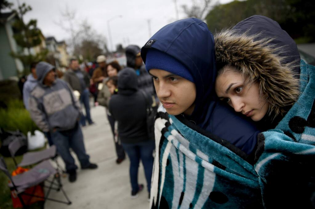 Julio Quinonez and his fiancee Michelle Ramirez wait in line to apply for the new Tierra Springs Apartments, for moderate and middle income households, at Terracina at Santa Rosa apartment complex in Santa Rosa, California on Wednesday, February 18, 2015. (BETH SCHLANKER/ The Press Democrat)