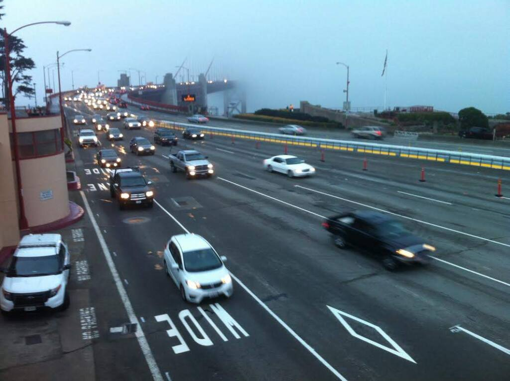 Traffic flows on the Golden Gate Bridge on Monday, Jan. 12, 2015. The bridge was reopened Sunday night after a weekend closure to install a safety barrier. (BETH SCHLANKER/ PD)