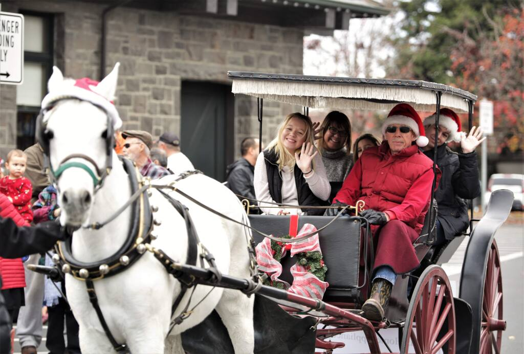 Families enjoyed holiday horse and carriage rides in historic Railroad Square in Santa Rosa, Sunday December 24th, 2017. (photo Will Bucquoy/for the Press Democrat).
