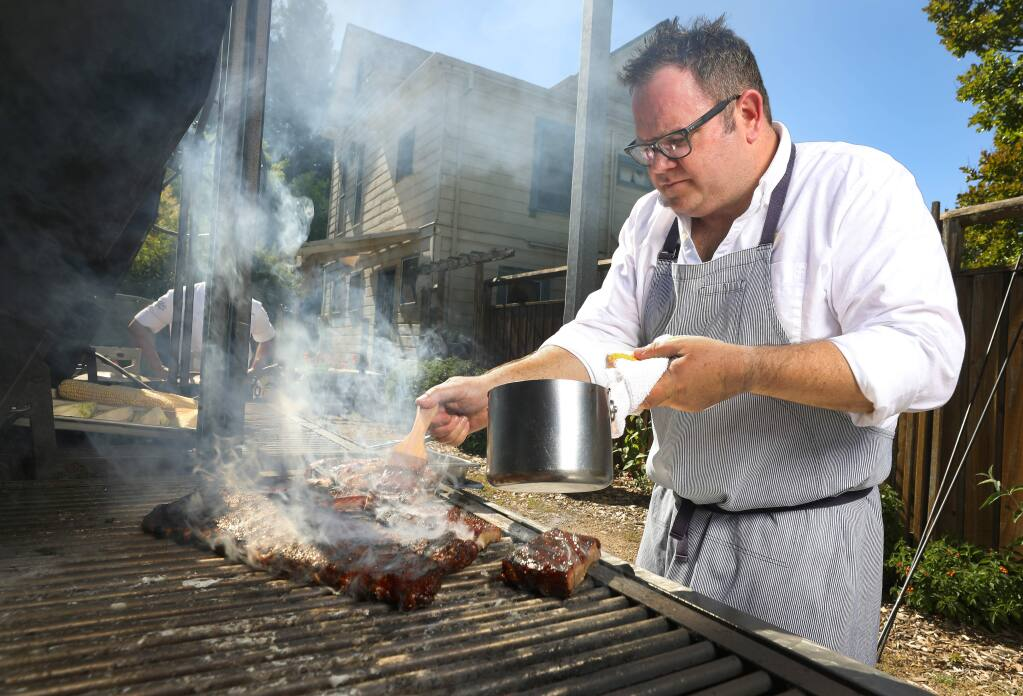 Seghesio Family Vineyards executive chef Peter Janiak brushes St. Louis cut ribs with the Seghesio Kitchen Zinfandel BBQ Sauce.