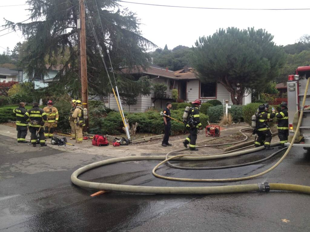 Scott Manchester/Argus-Courier StaffFire crews responded to a house fire on Melvin Street Friday, Nov. 21.