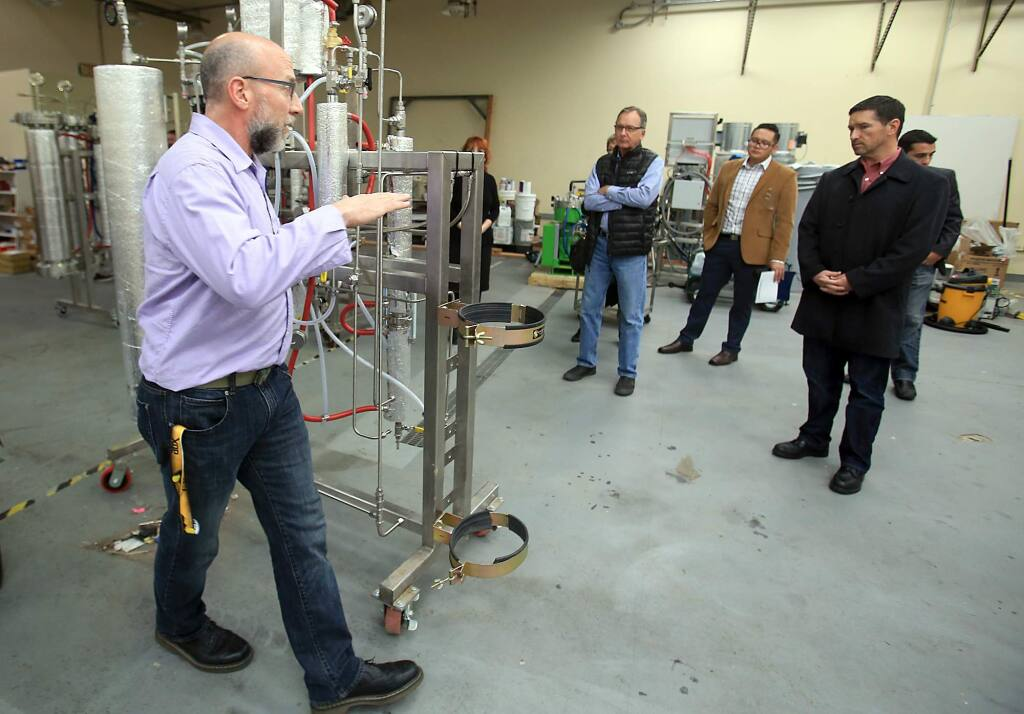 Greg Galardy of CBD Guild explains how C02 fluid extraction machines produce cannabis concentrates in Santa Rosa on Wednesday, Dec. 14, 2016. (KENT PORTER/ PD)