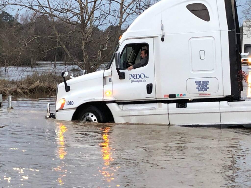 A truck navigates high water from the flooded Petaluma River behind Industrial Avenue in Petaluma on Jan. 17, 2019. MATT BROWN/ARGUS-COURIER STAFF