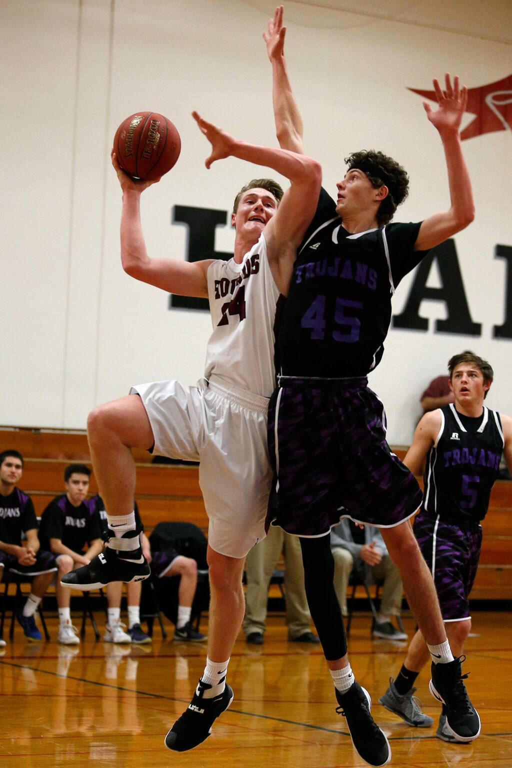 Healdsburg's Landon Courtman (24), left, goes for a shot while guarded by Petaluma's Joey Potts (45) during the first half of a boys varsity basketball game between Petaluma and Healdsburg high schools in Healdsburg, California on Tuesday, January 3, 2017. (Alvin Jornada / The Press Democrat)