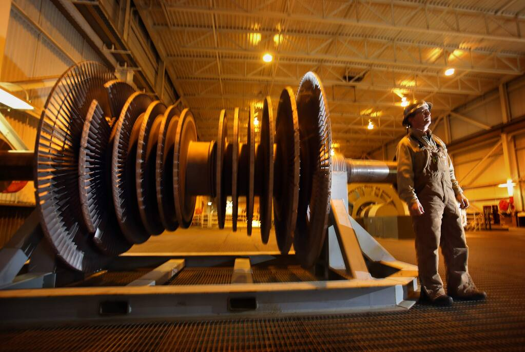 (FILE PHOTO) An operator stands next to a steam turbine used to produce power at the Calpine facility in The Geysers. The City of Healdsburg has become the second city in Sonoma County to operate on 100 percent renewable power. It gets most of its power from The Geysers. (John Burgess/The Press Democrat)