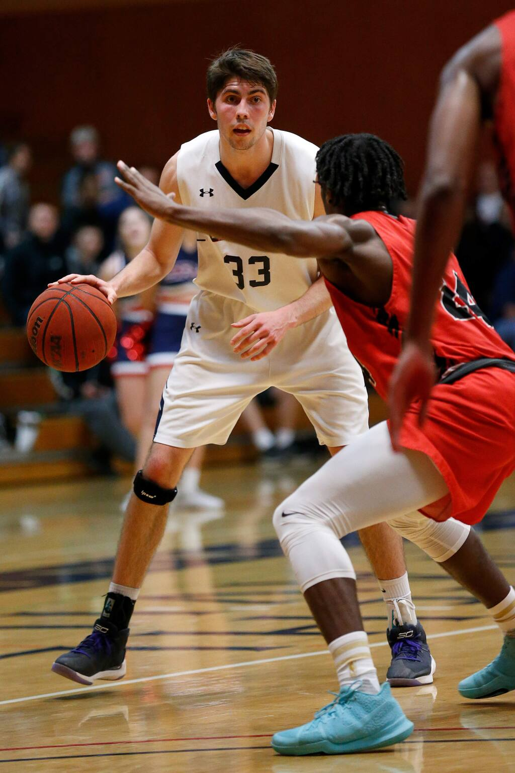 SRJC's Skylar Chavez (33) faces off against Las Positas's Nana Appiah during the second half of the CCCAA first-round playoff game at Haehl Pavilion in Santa Rosa on Friday, March 1, 2019. (Alvin Jornada / The Press Democrat)