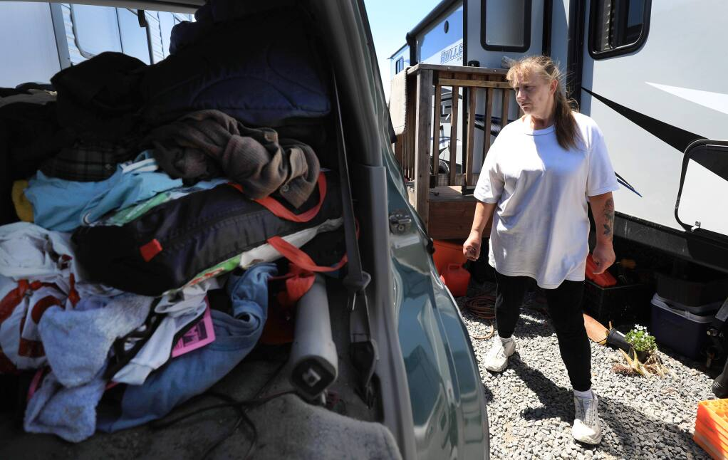 Pam Peavler and boyfriend Scott Struckman (not pictured) are vacating from their FEMA trailer, right, and packing to leave the Sonoma County Fairgrounds RV Park, Friday, May 10, 2019 in Santa Rosa. (Kent Porter / The Press Democrat) 2019