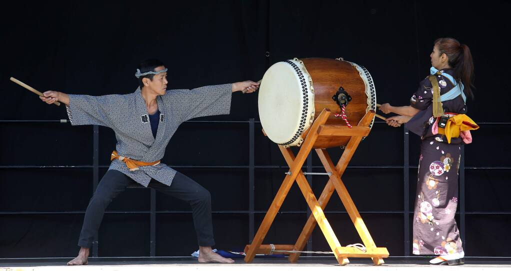 Hideaki Nishikura, left, and Hitomi Kimura performed the Hachijo Daiko Opening during the Matsuri Japanese Arts Festival held at Juilliard Park Saturday, May 2, 2015. (CRISTA JEREMIASON / PD)