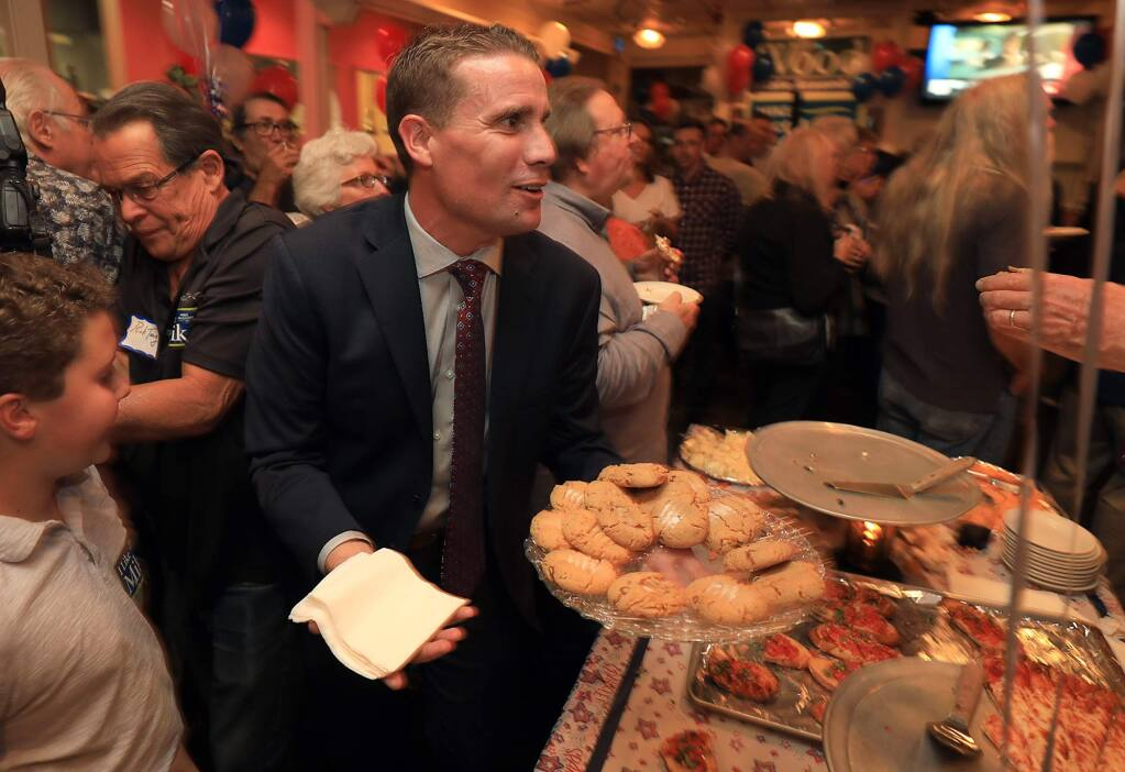 Senator Mike McGuire hands out cookies at the Democrat victory party at the Union Hotel Restaurant on College Ave. in Santa Rosa, Tuesday, Nov, 6, 2018. (Kent Porter / The Press Democrat) 2018