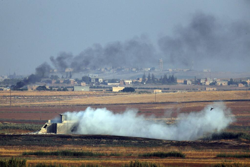 In this photo taken from the Turkish side of the border between Turkey and Syria, in Akcakale, Sanliurfa province, southeastern Turkey, smoke billows from targets inside Syria during bombardment by Turkish forces Wednesday, Oct. 9, 2019. Turkey launched a military operation Wednesday against Kurdish fighters in northeastern Syria after U.S. forces pulled back from the area, with a series of airstrikes hitting a town on Syria's northern border. (AP Photo/Lefteris Pitarakis)