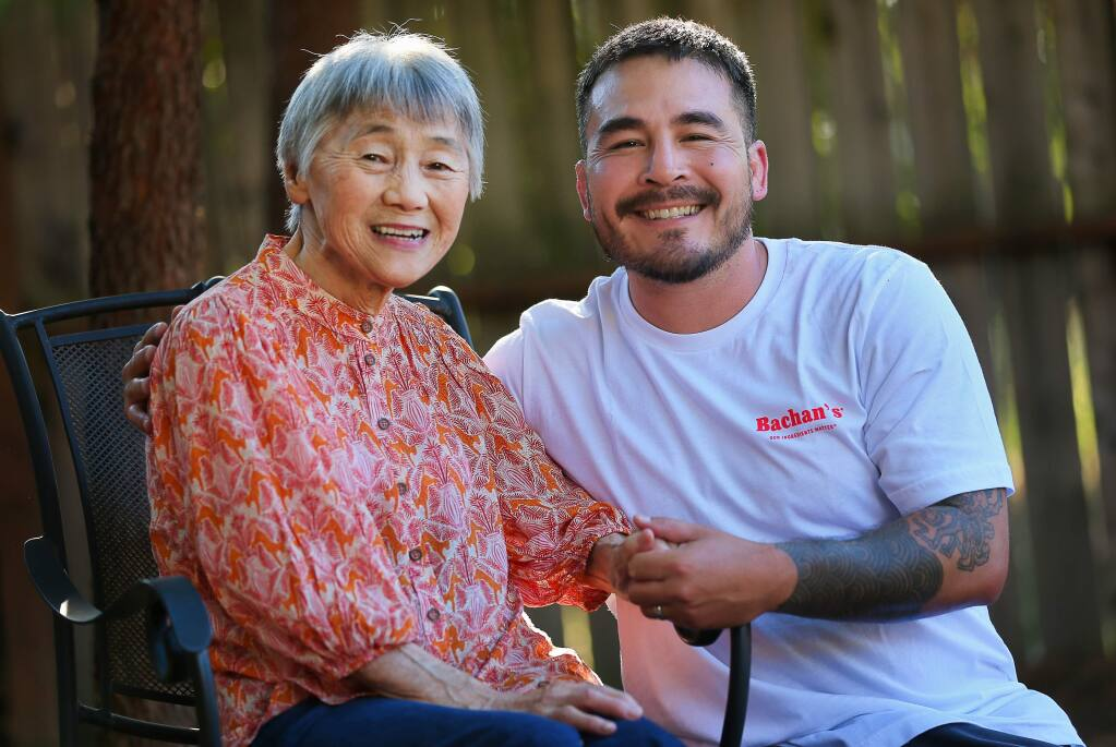 Justin Gill with his grandmother, Judy Yokoyama, who he calls Bachan. Gill is the founder of Bachan's Japanese Barbecue Sauce, inspired by his grandmother.(Christopher Chung/ The Press Democrat)