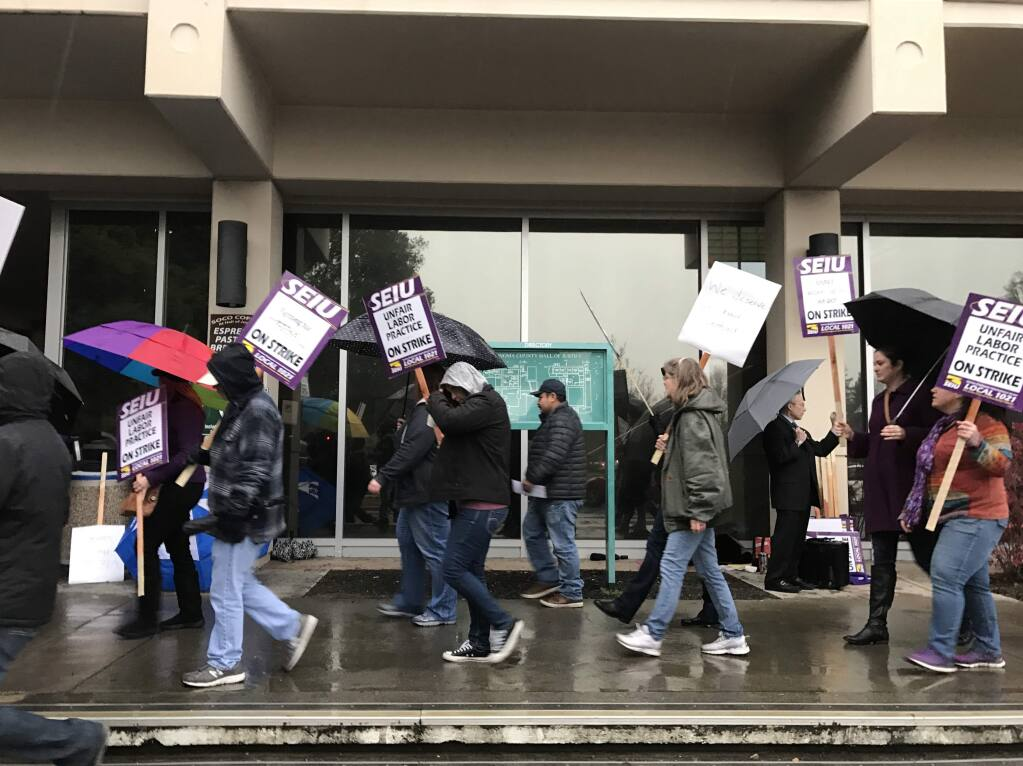 Court clerks, legal assistants and court reporters strike in front of the Sonoma County Superior Court in Santa Rosa on Wednesday, Jan. 18, 2017. (BETH SCHLANKER/ PD)