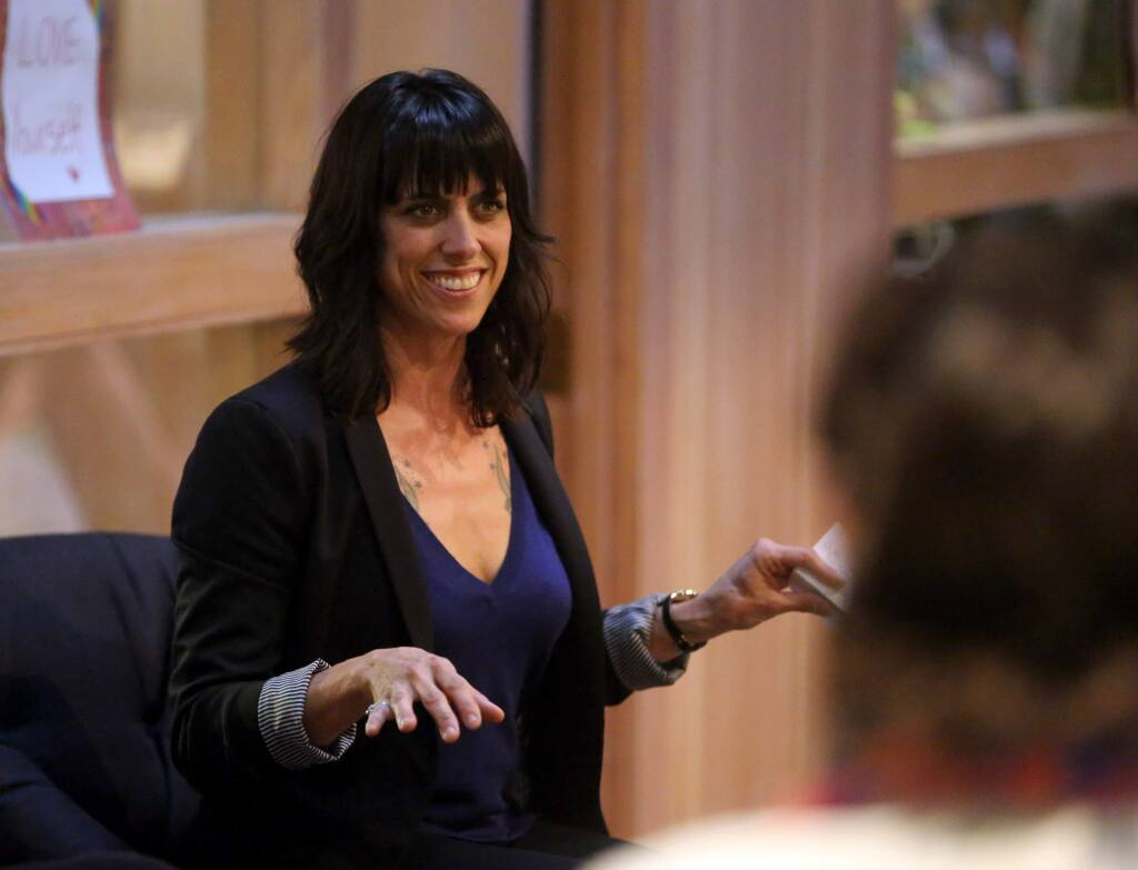 Julianna Carella, CEO and Founder of Auntie Dolores spoke during the Women Grow Sonoma County Chapter networking event held at ZDCA Design & Development, Thursday, July 9, 2015. (Crista Jeremiason / The Press Democrat)