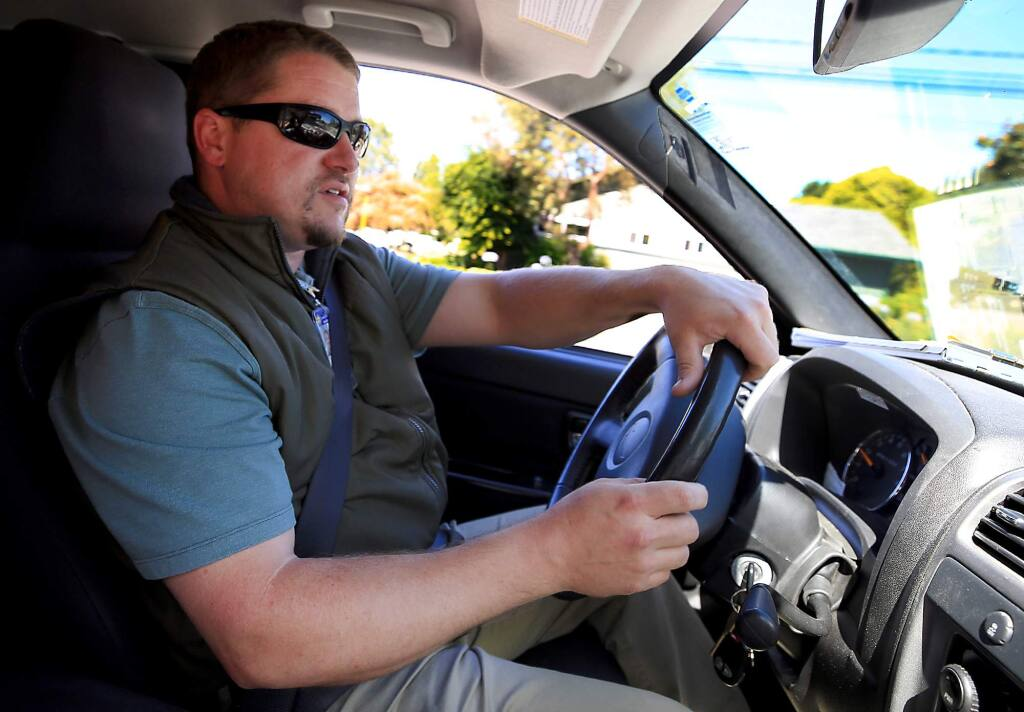 Andrew Smith, a senior agricultural biologist and standards specialist with County of Sonoma, cruises through Sonoma and performs outreach on pesticide use by landscapers and home gardeners, Tuesday June 27, 2017 in Sonoma. (Kent Porter / Press Democrat) 2017