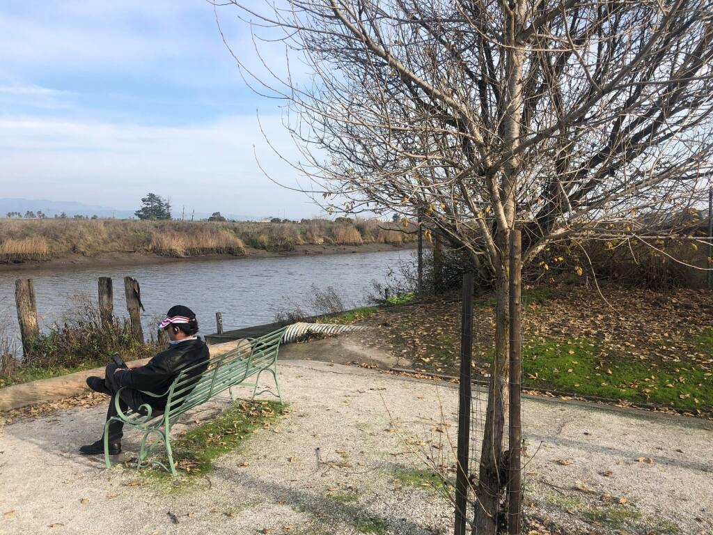 BENCHWARMER: A visitor has a phone conversation while overlooking the river at H Street Riverview Mini Park.(PHOTOS BY DAVID TEMPLETON)