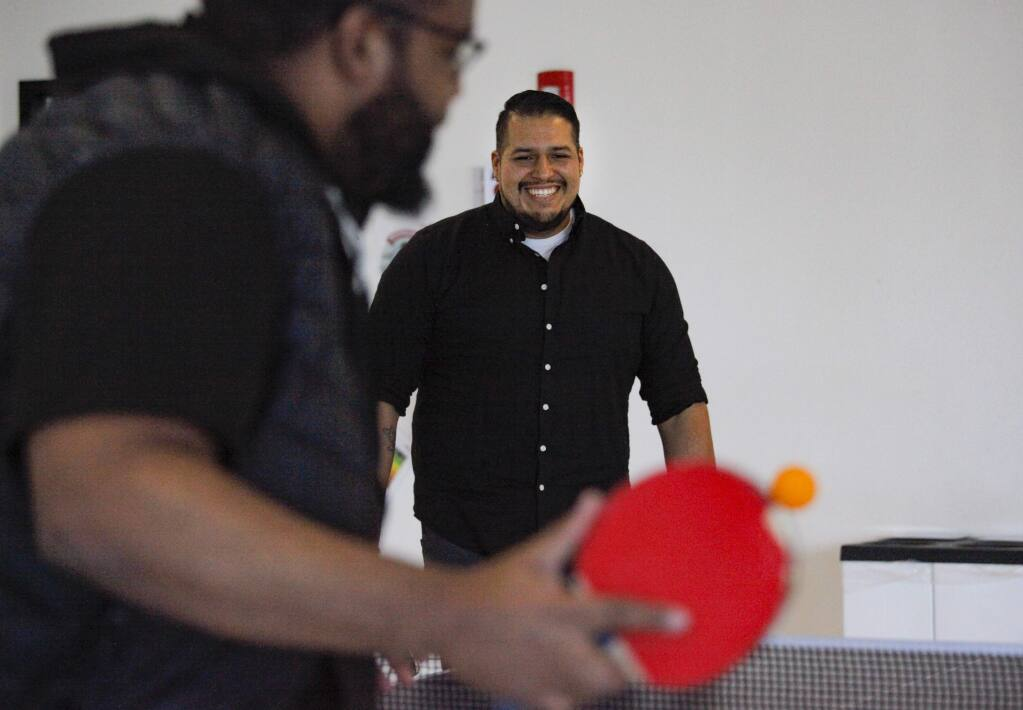 Petaluma, CA, USA._Tuesday, March 26, 2019. (Left to right) Simon Yohannes and Jonathan Arrospide enjoy playing ping pong during their break at Workrite Ergonomics. The Petaluma-based company provides several wellness opportunities to their employees. They will be participating in Petaluma Walking Day at Shollenberger Park on April 3rd. (CRISSY PASCUAL/ARGUS-COURIER STAFF)