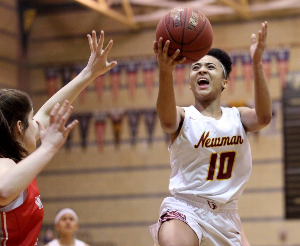 Cardinal Newman's Anya Choice scores against Montgomery in the first half of the North Bay League Oak Division final played at Windsor High, on Friday, Feb. 8, 2019. (Photo by Darryl Bush / For The Press Democrat)