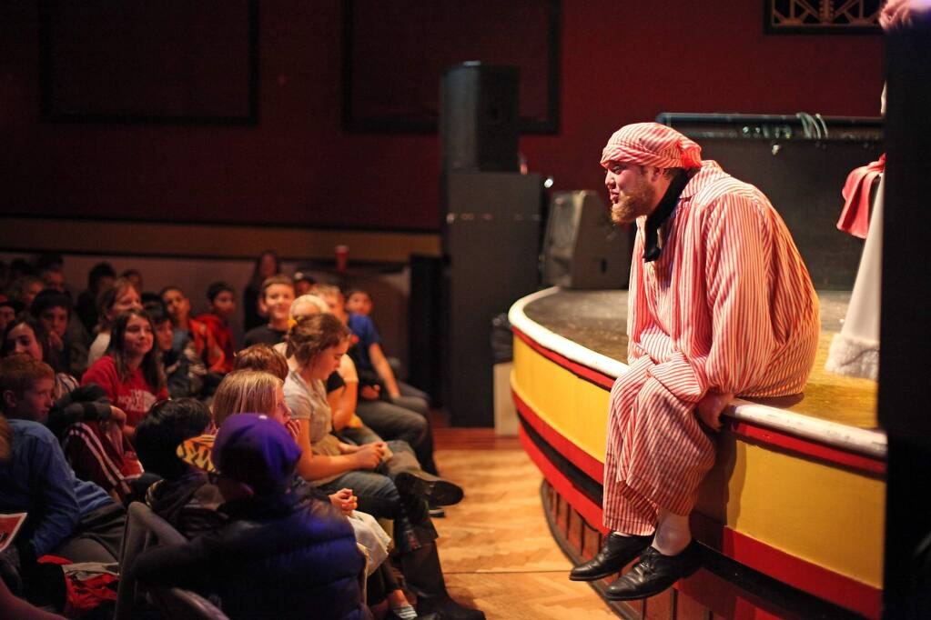 An actor from A Christmas Carol performs for an audience of 400 petaluma school kids for free at The Mystic Theater on December 3, 2014 (VICTORIA WEBB/FOR THE ARGUS-COURIER)