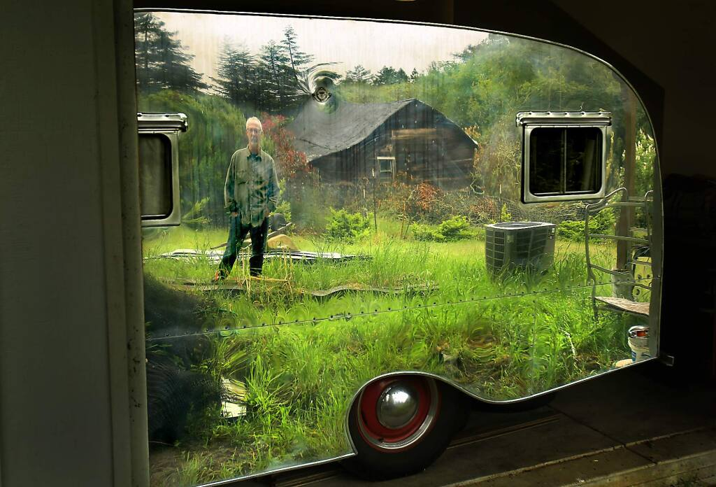 Michael Haworth of Sebastopol is reflected in a Little Caesar camper trailer that he owns, Friday May 6, 2016 in Sebastopol. The trailers were built after WWII by the Sokolis Brothers of Sebastopol. (Kent Porter / Press Democrat ) 2016