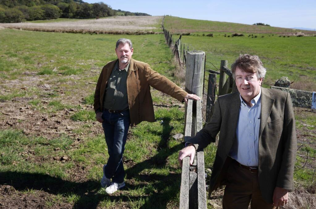 Former Petaluma City Councilman Matt Maguire and present Councilman Mike Healy stand at a gate to Lafferty Ranch. (BETH SCHLANKER / The Press Democrat)