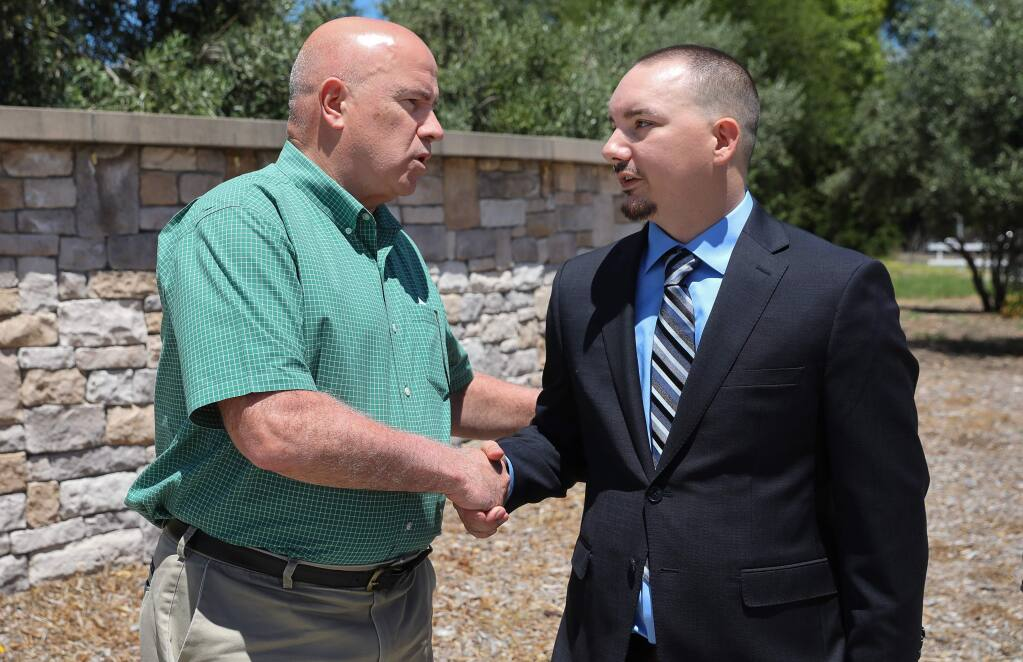 Robert Kennedy, right, shakes hands with Hanna Boys Center executive director Brian Farragher during his press conference in Sonoma on Wednesday, June 26, 2019. Kennedy and his brother, allegedly abused at the Hanna Boys Center, announced a $6.8 million settlement with the school. (Christopher Chung/ The Press Democrat)