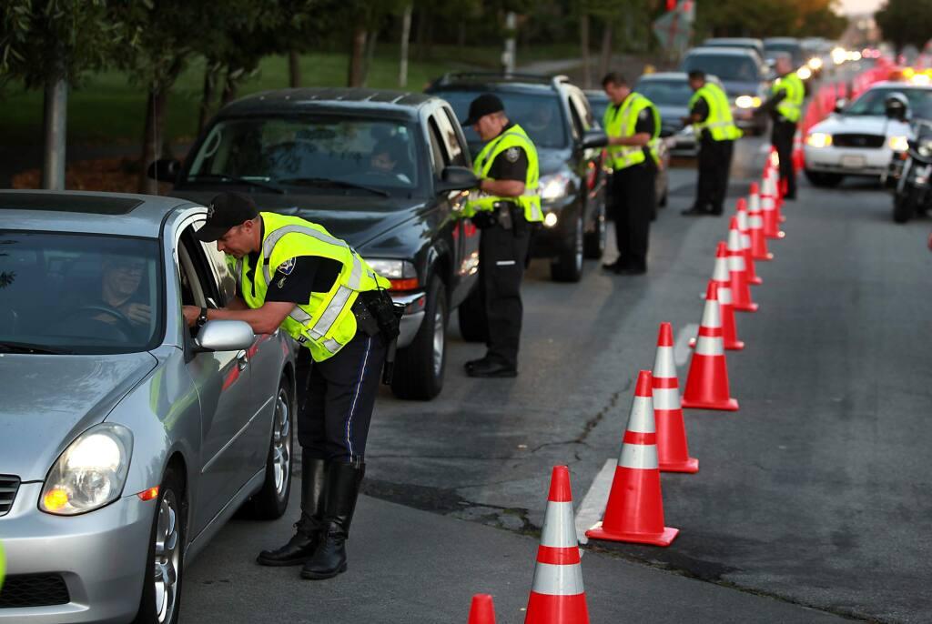 09/19/2011: A1: PC: Petaluma police officers conduct a DUI checkpoint on Sonoma Mountain Parkway, Friday Sept. 16, 2011 in Petaluma. (Kent Porter / Press Democrat) 2011