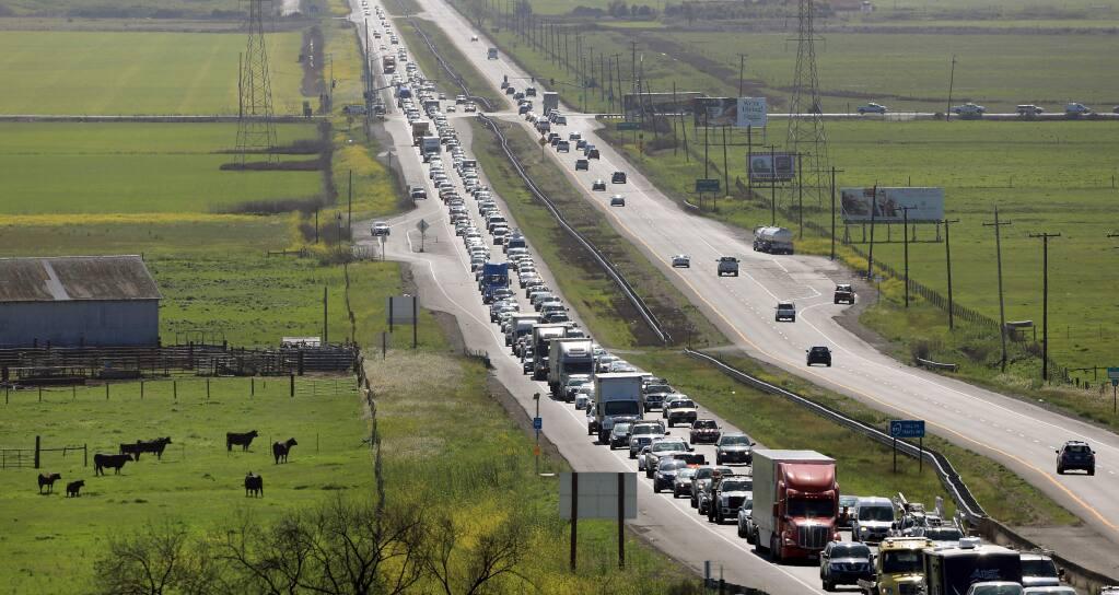 Traffic backs up along eastbound Highway 37 near Lakeville Highway on Monday, April 2, 2018. (Kent Porter/ The Press Democrat)