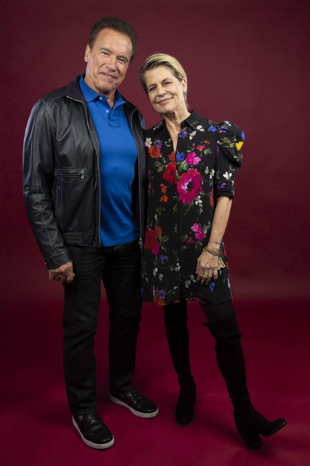 This Oct. 26, 2019 photo shows actor Arnold Schwarzenegger, left, and actress Linda Hamilton posing for a portrait to promote the film, 'Terminator: Dark Fate' at the Four Seasons Hotel Los Angeles at Beverly Hills in Los Angeles. (Photo by Willy Sanjuan/Invision/AP)