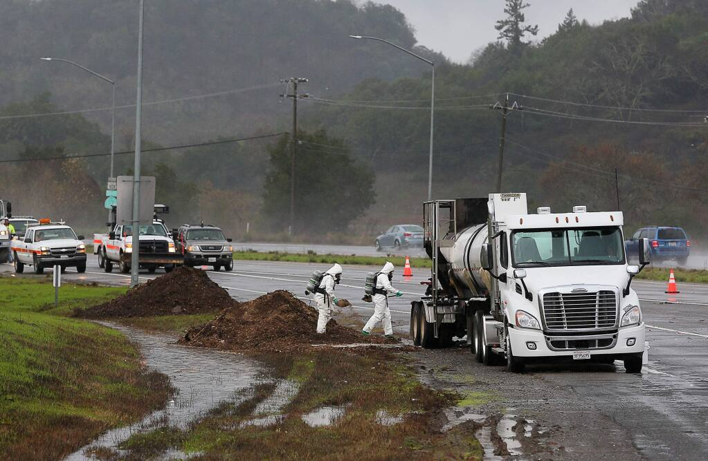 The right lane of northbound Highway 101 and the South Cloverdale Boulevard offramp are closed while a hazardous materials team works on containing a chemical spill after a truck caught fire in Cloverdale on Wednesday, December 18, 2019. (Christopher Chung/ The Press Democrat)