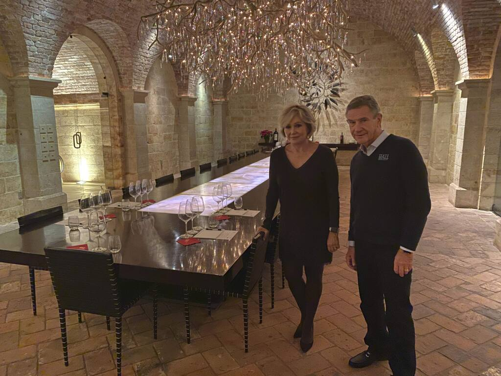 """Kathryn and Craig Hall, owners of Hall Rutherford Winery, stand inside the """"wine cave"""" dining room where they held a fundraising dinner for Democratic presidential candidate South Bend, Ind., Mayor Pete Buttigieg, Friday, Dec. 20, 2019, in Rutherford, Calif. They say their most expensive bottle of wine costs $350 and wasn't served at the fundraiser. (AP Photo/Terence Chea)"""