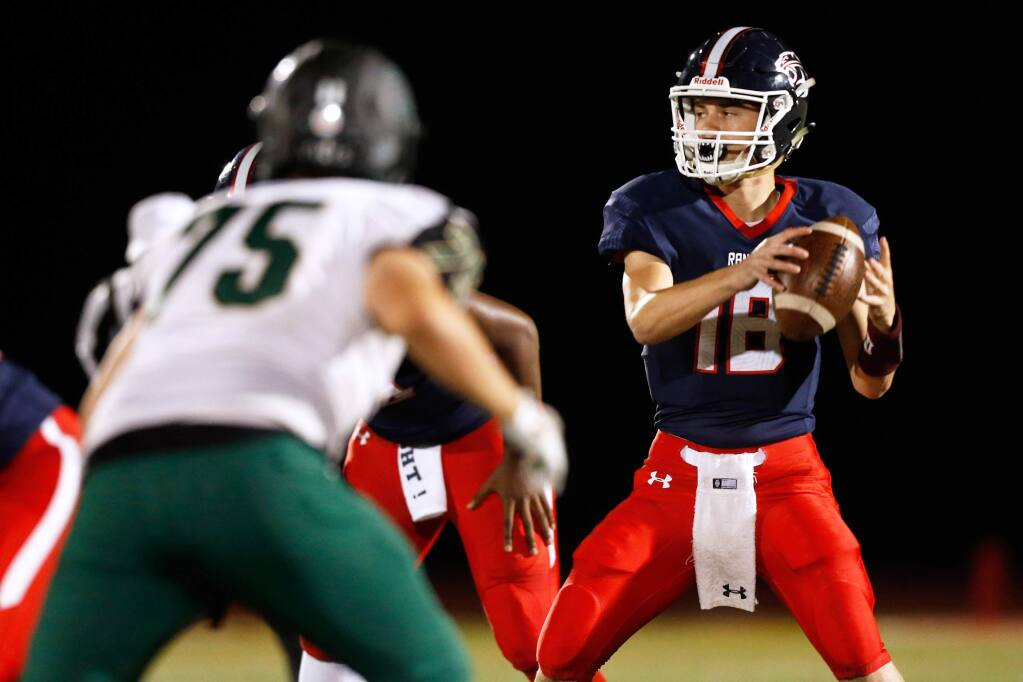 Rancho Cotate quarterback Jared Stocker (18), right, looks to throw during the first half of the NCS Division II varsity football playoff game between Casa Grande and Rancho Cotate high schools in Rohnert Park, California, on Friday, November 2, 2018. (Alvin Jornada / The Press Democrat)