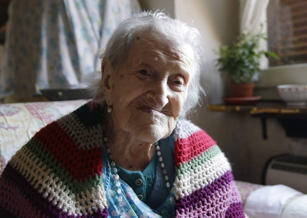 Emma Morano, 117 as of November 2016, sits in her apartment in Verbania, Italy, in this photo taken Friday, June 26, 2015. Morano and Susannah Mushatt Jones, also 115 at the time of the photo, of the Brooklyn borough of New York, were believed to be the last two people in the world with birthdates in the 1800s. (AP Photo/Antonio Calanni)