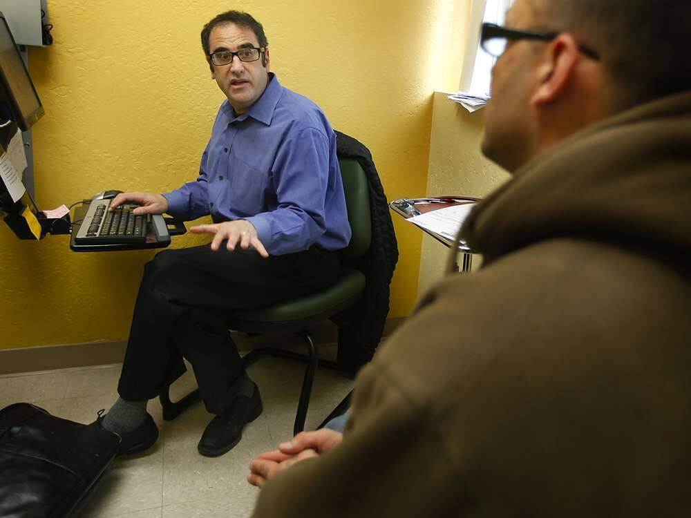 Psychiatrist Michael Kozart, medical director in Sonoma County's Health Services department, left, analyzes 35-year-old Jeremy Moore at the Brookwood Health Center Wednesday Dec. 14, 2011. (Kent Porter / Press Democrat) 2011