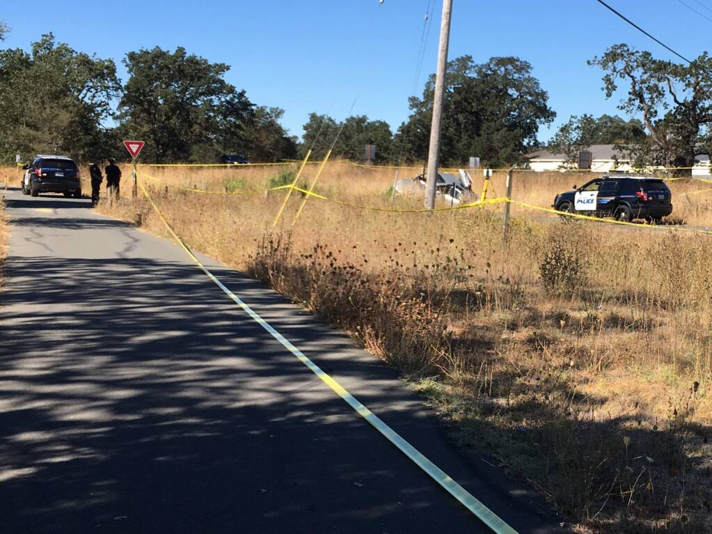 Santa Rosa police investigate a fatal crash at the western end of Sebastopol Road along the Jo Rodota Trail that followed a police pursuit Sunday, Sept. 18, 2016. (BRUCE BAIRD / PD)