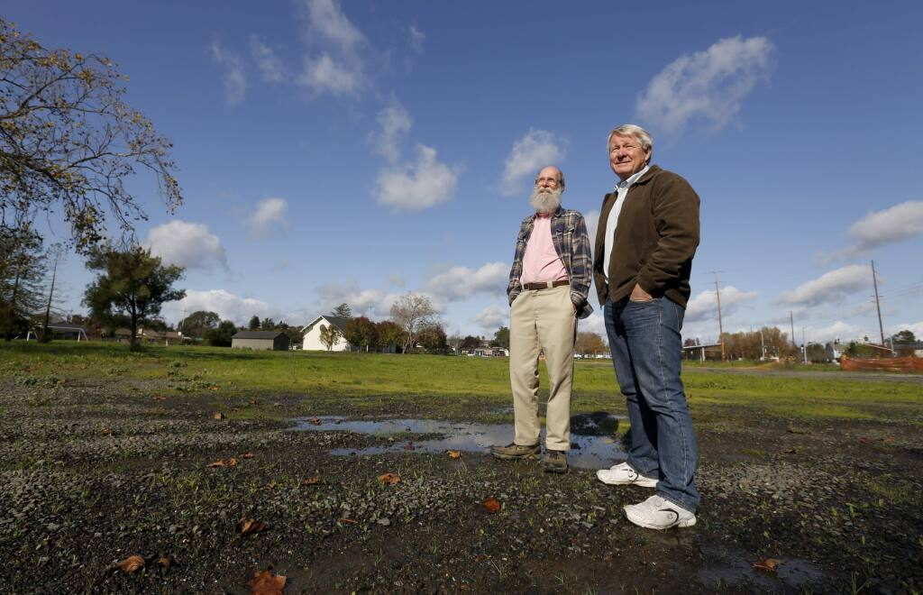 John Creager, left, and Paul O'Rear, members of the First United Methodist Church of Santa Rosa's Homeless Ministries Task Force committee, stand in the space on Giffen Ave which will be used for a temporary housing community for the homeless. Photo taken in Santa Rosa, on Wednesday, November 23, 2016. (BETH SCHLANKER/ The Press Democrat)
