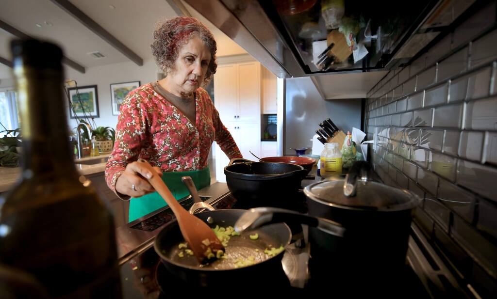 Marlena Hirsch cooks dinner in her Mark West Springs area home on Monday, Sept. 16, 2019. (KENT PORTER/ PD)